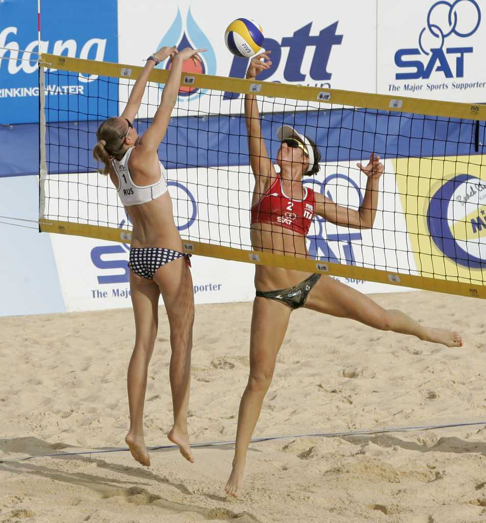 Italy's Laura Giombini competes at the net against Russia's Nadezda Makroguzova